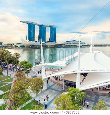 Singapore, Republic of Singapore - May 7, 2016: Panorama of Marina Bay with people strolling around outdoor theatre stage