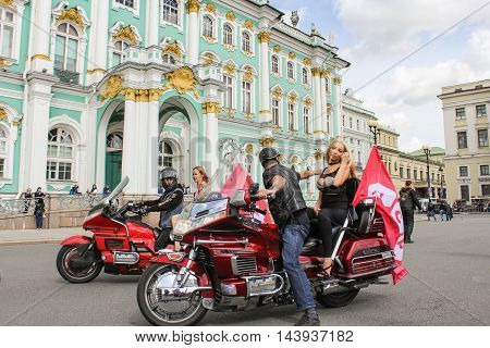 St. Petersburg, Russia - 13 August, Motorcycles with people at the Hermitage,13 August, 2016. The annual International Motor Festival Harley Davidson in St. Petersburg.