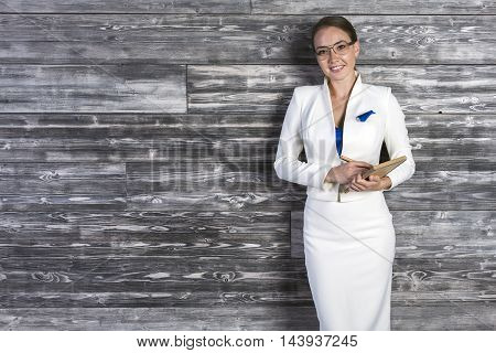 Happy Businesswoman With Notepad