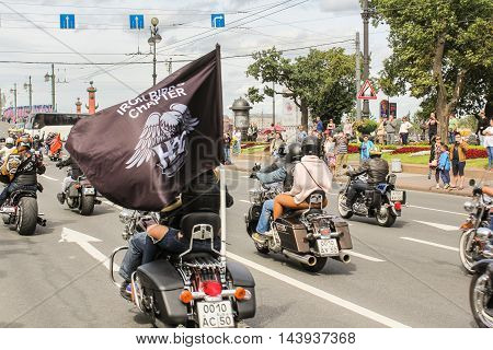 St. Petersburg, Russia - 13 August, Riding motorcycles with flag people,13 August, 2016. The annual International Motor Festival Harley Davidson in St. Petersburg.