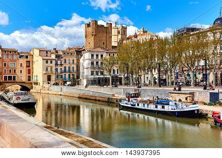 Narbonne France - April 8, 2016: The Canal de la Robine in Narbonne city. Languedoc-Roussillon France. Classed as a UNESCO world heritage site the Canal de la Robine is the main thoroughfare which gives the town its heartbeat