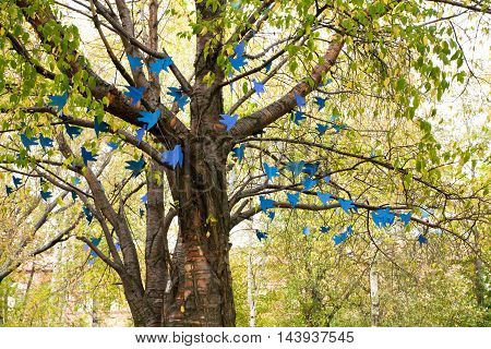 Blue Birds Of Paper Hanging On Tree