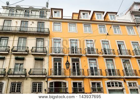 Typical colorful Lisbon house facades with balconies