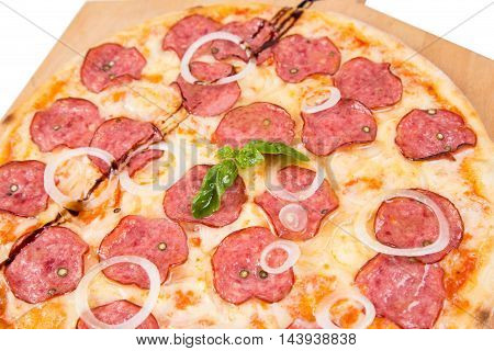 hot pizza with salami and onion isolated on white background