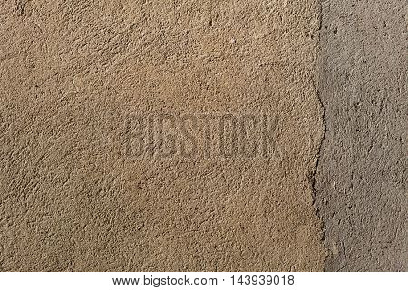 Beige painted stucco wall. Background texture.