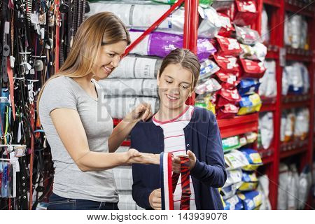 Mother And Daughter Shopping At Pet Store