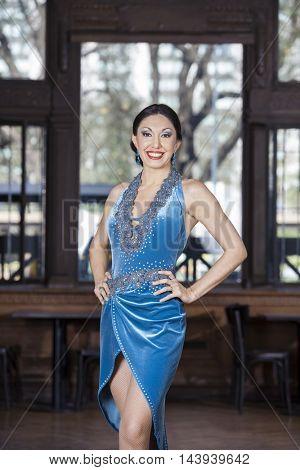 Tango Dancer With Hands On Hip In Restaurant