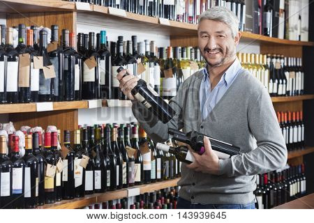 Male Customer Shopping For Wine Bottles In Store