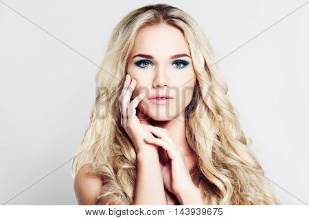 Pretty Blond Woman with Makeup and Blonde Curly Hair