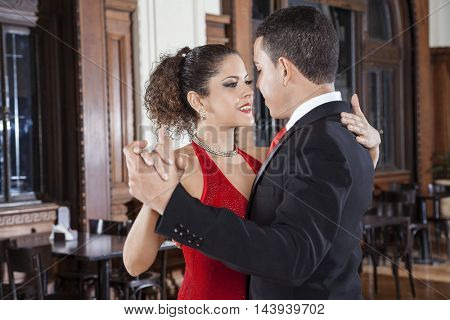 Tango Dancers Performing Gentle Embrace Step In Restaurant