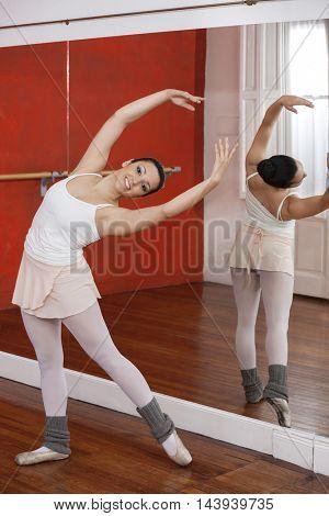Happy Ballerina Performing In Studio