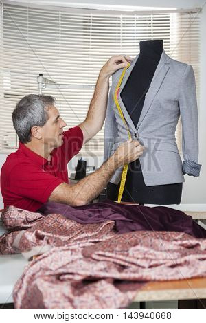 Tailor Measuring Suit On Mannequin