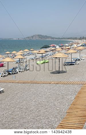 CALIS, TURKEY, 31ST JULY 2016:Umbrellas and sunbeds along Calis beach in Turkey,31st july, 2016