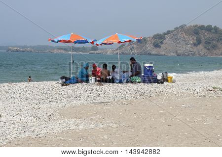 31ST JULY 2016, CALIS, TURKEY : A Turkish family having lunch on calis beach in turkey, 31st july 2016