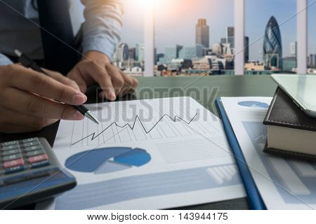 Businessman scrutinizing business plan or report man work