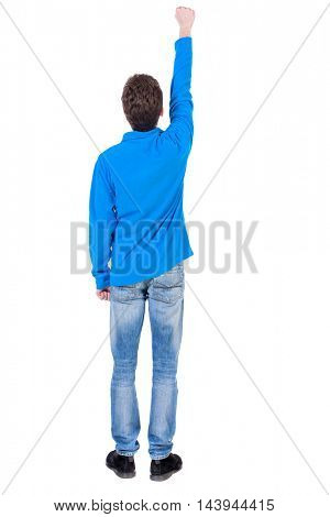 Back view of  man.  Raised his fist up in victory sign.  Rear view people collection.  backside view of person.  Isolated over white background. A guy in a Curly boy in a blue sweater in pose of the