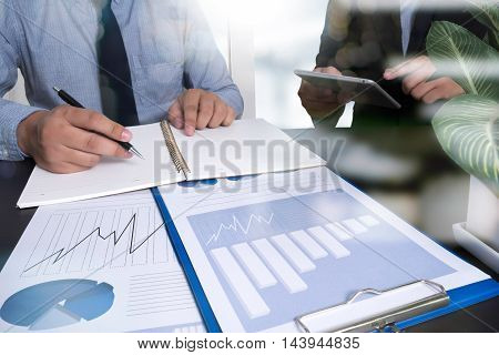 Business Documents On Office Table With Smart Phone