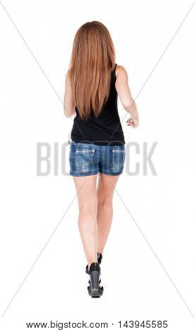 back view of running  woman. beautiful red head girl in motion. backside view of person.  Rear view people collection. Isolated over white background.