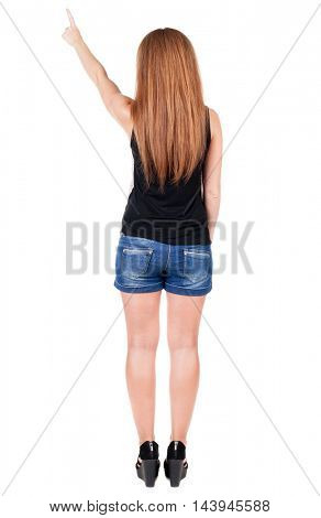 Back view of  pointing woman. beautiful redhead girl in shorts. Rear view people collection.  backside view of person.  Isolated over white background.