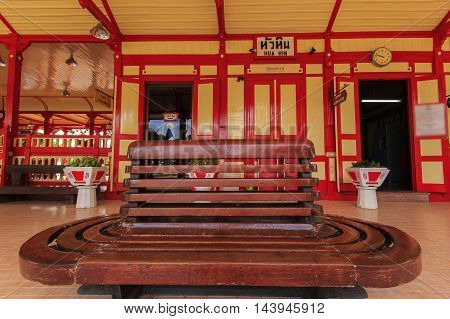 Old wooden chair at Hua Hin Railway Station is a famous place Thailand.