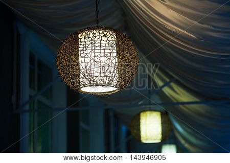 included chandeliers in the evening cafe outdoor.