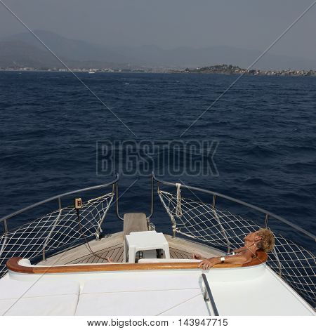 2ND AUGUST 2016, FETHIYE,TURKEY; An old retired english lady asleep and resting while on a boat trip during the summertime in Fethiye , turkey, 2nd august 2016
