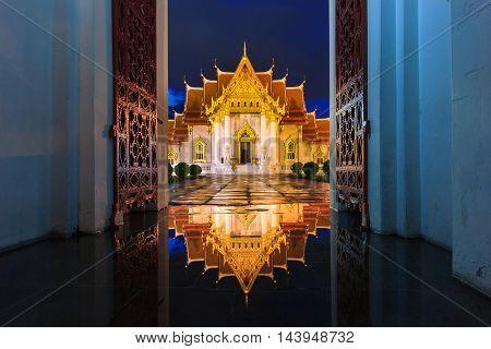 Wat Benchamabophit in Bangkok at twilight time with reflection on the water after hard raining Bangkok Thailand