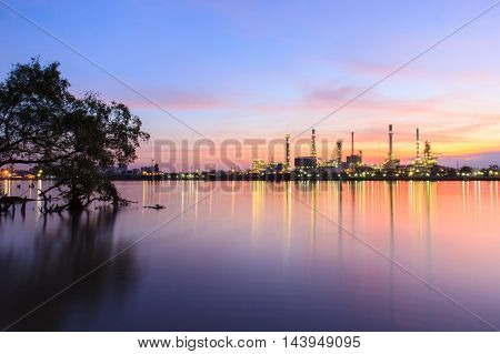 Oil refinery and surrounding environment at twilightChao Phraya river Thailand