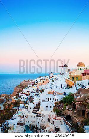 Oia Town on Santorini Island Greece. Sunrise. Traditional Houses and Churches over the Caldera Aegean Sea