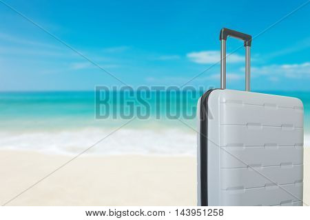 suitcase baggage on the sand on the beach with blue sky