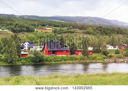 AL, NORWAY - JULY 2, 2016: This is a typical small settlement along the river Hallingdalselve.