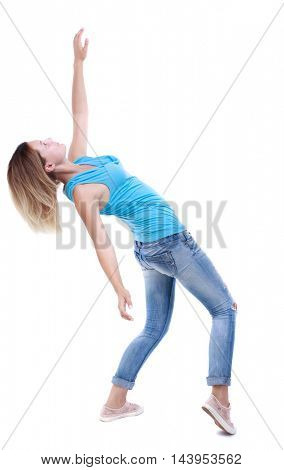 Balancing young woman.  or dodge falling woman. Rear view people collection.  backside view of person.  Isolated over white background. The blonde in a blue shirt and jeans leans back.