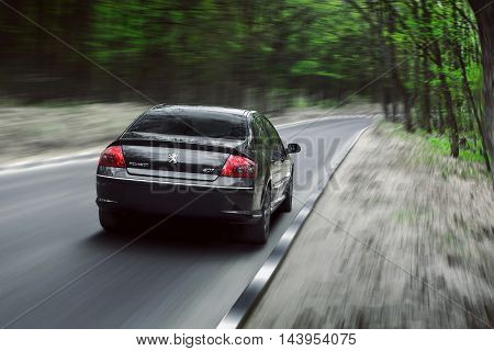Saratov, Russia - May 02, 2015: Car Peugeot 407 drive on asphalt countryside forest road at daytime