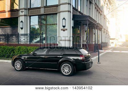 Saratov, Russia - August 9, 2015: Black Car Chrysler 300C Standing On Asphalt Road In The City At Da