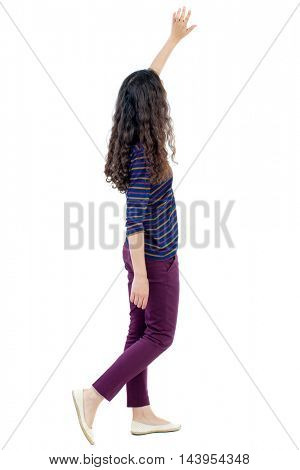 back view of walking woman welcomes. beautiful girl hand waving from. backside view of person.  Rear view people collection. Isolated over white background. Long-haired curly girl goes past the camera