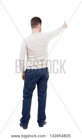Back view of pointing business man.  Rear view people collection.  backside view of person.  Isolated over white background. The bearded man in a white warm sweater shows finger forward.