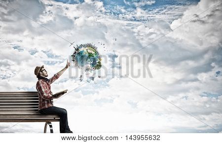 Hipster guy with book in hands . Mixed media
