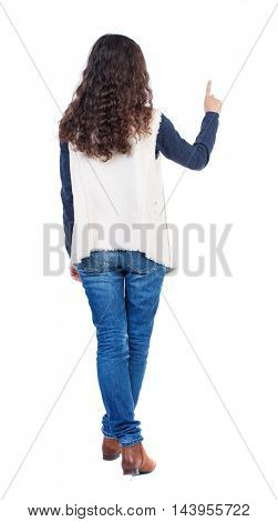Back view of  woman thumbs up. Rear view people collection. backside view of person. Isolated over white background. Long-haired girl with curly hair finger presses the button.