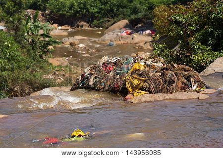 Water rubbish pollution with cloth and other floating stuffs, Tamil Nadu, India. Garbage