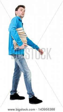 side view of going  man carries a stack of books. walking young guy . Rear view people collection.  backside view of person.  Isolated over white background.
