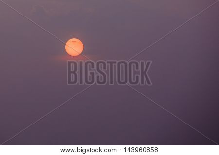 Close View Of Orange Disk Of Setting Rising Sun, Violet Cloudless Sky Background, Sunrise, Sunset, Dawn.