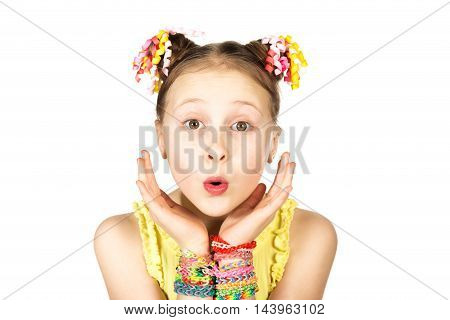 Surprised girl with a fashionable hairstyle with trendy handmade weaving bracelets on a white background