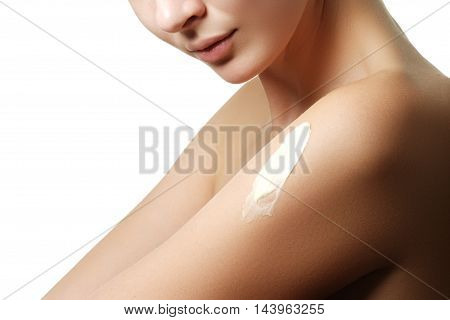 Close-up Of A Woman Cares About Her Shoulder Applying Cosmetic C