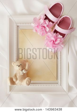 blank photo frame with baby shoes. baby shower invitation