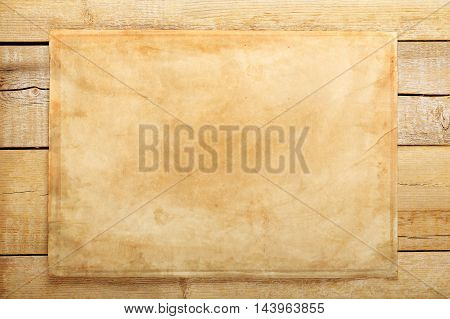 sheet of aged paper on weathered wooden planks