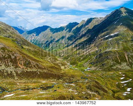 Small hut in the green alpine valley on sunny spring day, Austrian Alps, Austria
