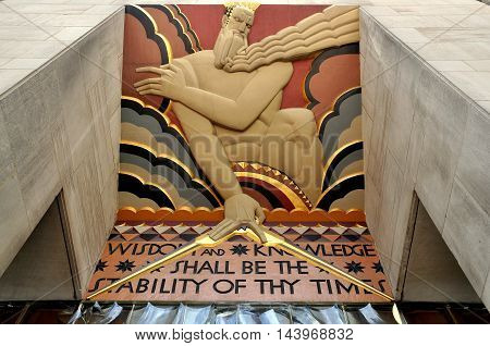 New York City - August 14 2009: Art deco bas relief over east entrance to the GE Building at Rockefeller Center