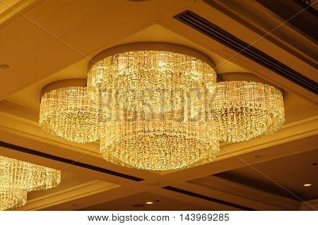Close-up of a beautiful crystal chandelier .