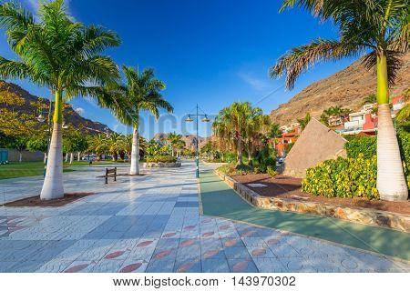 Promenade in Puerto de Mogan, a small fishing port on Gran Canaria, Spain.