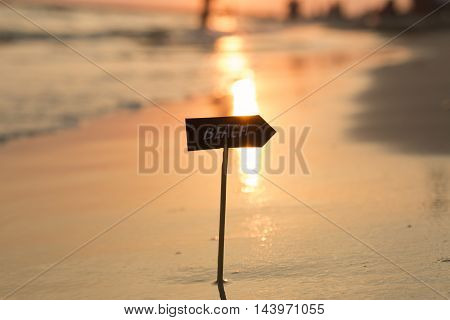 Vacation holidays concept - inscription beach and sunset